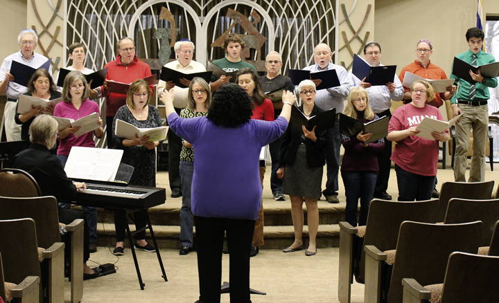 Cantor Jenna Greenberg conducts the Dayton Jewish Chorale in a rehearsal of Then Moses Sang by Cantor Jerome B. Kopmar at Beth Abraham Synagogue