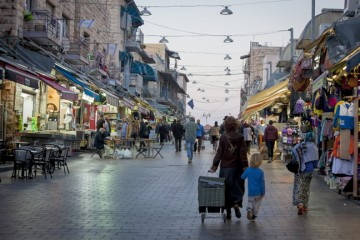 Pedestrians at the Mahane Yehuda market — one of the writer's favorite spots in Jerusalem — on the day of a stabbing attack, Nov. 23. Photo by Esther Rubyan/Flash90