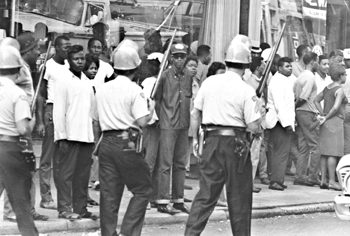 Dayton Police Officers clear the streets in the aftermath of the rioting, September 1966. Collection of Daniel L. Baker and Gwen Nalls.