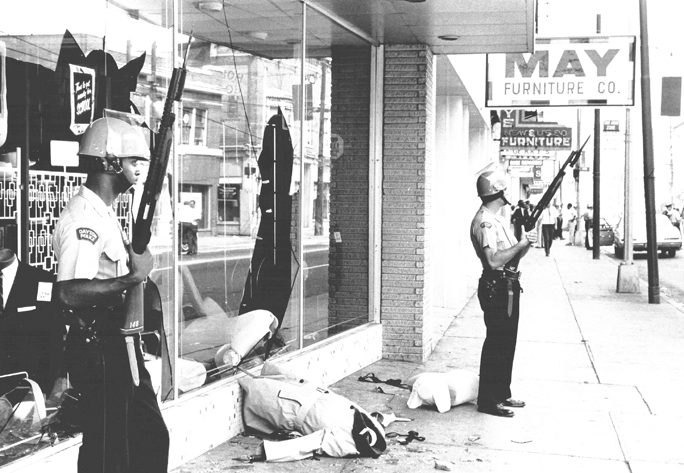 Dayton Police Officers with fixed bayonets in the riot zone on West Third Street, 1966. Dayton Daily News Archive, Wright State Univ.