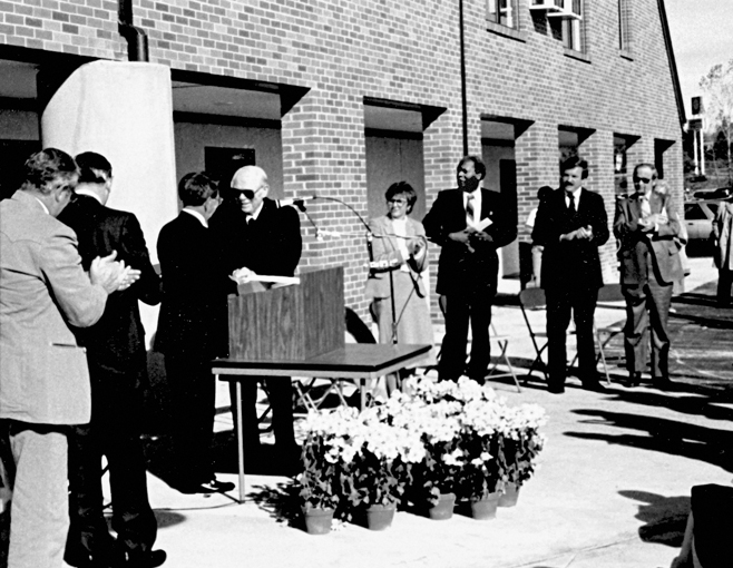 Jesse Philips (at podium, L) congratulates Robert Shapiro on Nov. 6, 1983 at the dedication of Covenant Manor in Trotwood. Shapiro served as Covenant Manor's first board chair.
