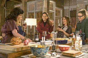 On Younger, Maggie (Debi Mazar, L), hosts a Shabbat dinner for her love interest, Malkie (Sally Pressman), and her friends. TV Land