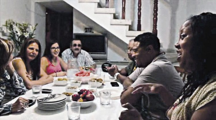 Wilberforce alumni reunite with the Bitran family from the Jesse Cohen neighborhood of Holon, Israel in a scene from the documentary, Taking Israel. AMMAK Productions.