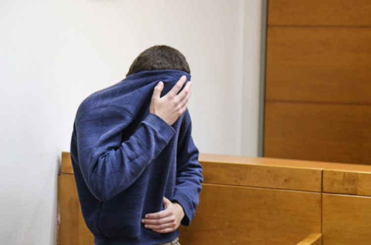 A teenager suspected of being behind over 100 bomb threats to Jewish Community Centers in the U.S. showing up at the Rishon Lezion Magistrate's Court in Israel, March 23, 2017. (Flash90)