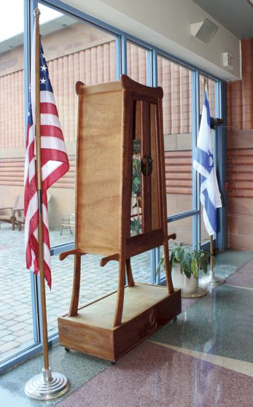 By a vote of 46 to 44, Temple Israel congregants decided on May 7 to keep the flags of the United States and Israel in the lobby of its building (shown here, surrounding the temple's portable Torah ark) rather than move them to the front of the main sanctuary
