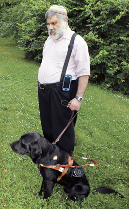 Moshe Segal recently acquired his first guide dog, Orion. Photo: Marshall Weiss.
