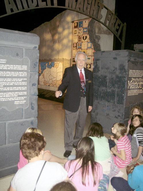 Volunteer Ira Segalewitz tells students about his experiences during the Holocaust in front of the Prejudice and Memory exhibit, on permanent display at the National Museum of the U.S. Air Force . Photo: JWV Post 587.
