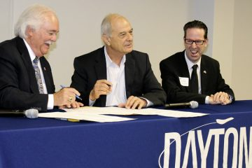 Dayton Area Chamber of Commerce Pres. Phil Parker (L) signs a ceremonial memo of understanding with Federation of Israeli Chambers of Commerce Pres. Uriel Lynn (Center) and its CEO, Dan Carmely, on July 21 at Business Solutions Center