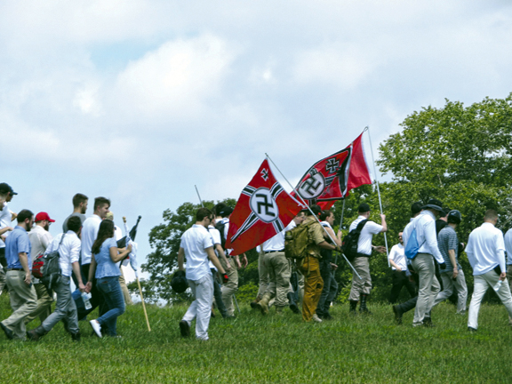 Holding Nazi flags, white supremacists march at a park in Charlottesville, Va., protesting the removal of a statue of Confederate Gen. Robert E. Lee, Aug. 12. Photo: Ron Kampeas/JTA.