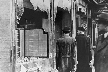 "Shattered storefront of a Jewish-owned shop destroyed during Kristallnacht (the ""Night of Broken Glass""). Berlin, Germany, November 10, 1938. — National Archives and Records Administration, College Park, Md."
