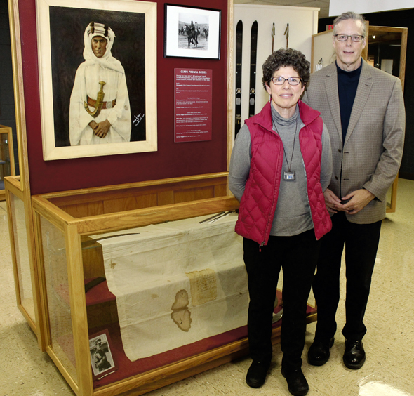 Garst Museum President & CEO Dr. Clay Johnson and board member Eileen Litchfield with the portion of the surrender flag of the Battle of Jerusalem, offered Dec. 9, 1917, on permanent display at the Garst Museum in Greenville as part of its Lowell Thomas collection. Photo: Marshall Weiss.