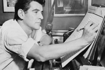 Leonard Bernstein making annotations to a musical score. Library of Congress.