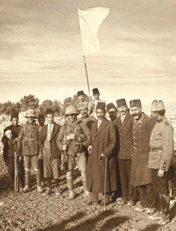 Mayor of Jerusalem Hussein al-Husayni (center, with cane and cigarette) and his entourage attempt to deliver the Turkish governor's letter surrendering the city to Sgts. James Sedgwick and Frederick Hurcombe of 2/19th Battalion, London Regiment, outside Jerusalem's western limits, Dec. 9, 1917. Photo: Lewis Larsson.