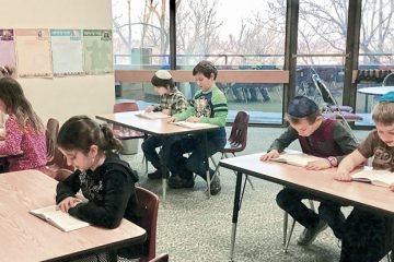 Fourth- and fifth-grade students at Hillel Academy Jewish day school study the Book of Joshua