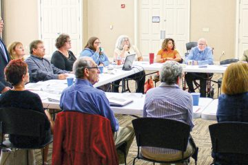 Dr. Robert Goldenberg, co-chair of the Dayton Jewish Cemeteries Steering Committee (standing) leads a presentation for synagogue leaders in August. Bruce Feldman (R) is also co-chair of the steering committee.