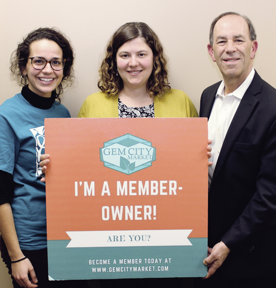 Greater Dayton Union Co-op Initiative Executive Director Lela Klein,  (Center), Hall Hunger Initiative Manager Etana Jacobi, and Hall Hunger Initiative Senior Advisor Rick Carne are working on an aggressive plan to open the Gem City Market on lower Salem Avenue in late 2019. A September 2016 Food and Research Action Center Report ranked Dayton second nationally for families with children who experience food hardship. Photo: Marshall Weiss.