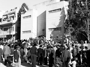 Fred Scheuer was in this crowd outside the Tel Aviv Museum of Art on May 14, 1948 listening by loudspeaker to Jewish Agency Chairman David Ben-Gurion read Israel's Declaration of Independence to members of Israel's provisional government inside the building. GPO.