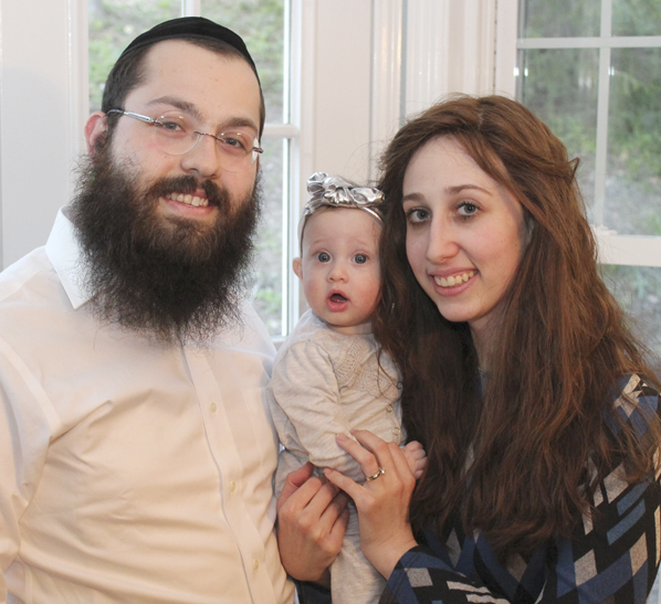 Mussie & Rabbi Elchonon Chaikin with their daughter, Esther. Photo: Marshall Weiss.