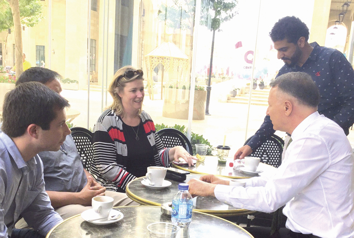 In the West Bank Palestinian city of Rawabi (L to R) South Bend Mayor Pete Buttigieg and Dayton Mayor Nan Whaley meet with Rawabi Mayor Ibrahim Natour (standing) and Bashar Masri, developer of the new city. Photo: AJC.