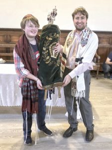 Esther Thorpe (L) identifies as non-binary and had a gender-neutral B'nai Mitzvah ceremony with the help of Student Rabbi Gabriel Webber. Courtesy of Miriam Taylor Thorpe.