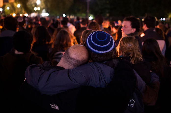 Members and supporters of the Jewish community hug at a candlelight vigil in front of the White House for the victims of the synagogue shooting in Pittsburgh, Oct. 27, 2018. (Andrew Cabbalero-Reynolds/AFP/Getty Images)