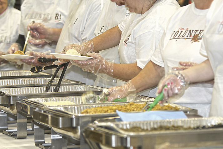 Volunteers serve dinner at the Feast of Giving, Thanksgiving in Dayton 2017. Photo: Feast of Giving.