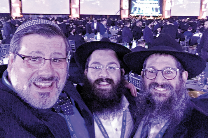 At the annual International Conference of Chabad-Lubavitch Emissaries (L to R): Dayton Jewish Observer Editor & Publisher Marshall Weiss with Rabbi Elchonon Chaikin & Rabbi Nochum Mangel of Chabad of Greater Dayton.