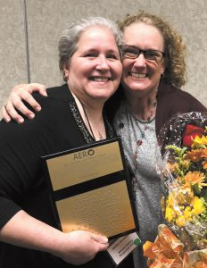 Hallie Greenfield (L) received the AERO 2018 Outstanding Ohio Orientation and Mobility Specialist Award from Dr. Danene Fast