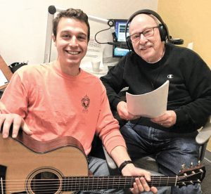 Jerry Halasz (R) and grandson Grant Halasz record a Chanukah program for Radio Reading Service. Photo: RRS.