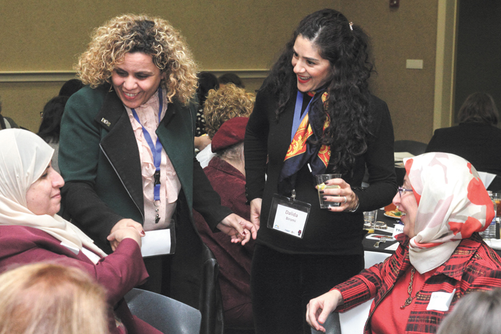 Israelis (standing, from L) Hanaa Younis and Dalida Biromi meet Daytonians (seated, from L) Salwa Shalash and Dr. Ramzieh Azmeh at the Boonshoft CJCE for a Partnership2Gether women's dialogue program. Photo: Peter Wine.