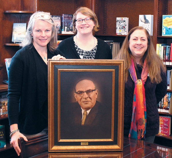 With Max Kohnop's portrait at Oakwood's Wright Memorial Public Library (L to R): Kate Chesar and Tracy Staley, library PR & community engagement specialists, and Kristi Hale, library director. Photo: Marshall Weiss.