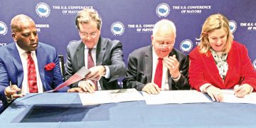 Signing the agreement on Jan. 24 between the American Jewish Committee and The U.S. Conference of Mayors for AJC to host annual trips to Israel for U.S. mayors (L to R): Conference of Mayors Pres. Steve Benjamin, mayor of Columbia, S.C.; AJC CEO David Harris; Conference of Mayors CEO/Exec. Dir. Tom Cochran; and Conference of Mayors International Committee Chair Nan Whaley, mayor of Dayton. Photo: The U.S. Conference of Mayors.