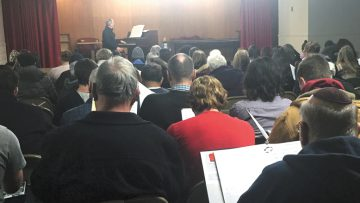 Dayton Philharmonic Music Director Neal Gittleman (at piano) leads the first rehearsal with members of six choirs for the Unity Through Harmony concert. Photo: Cantor Jenna Greenberg.