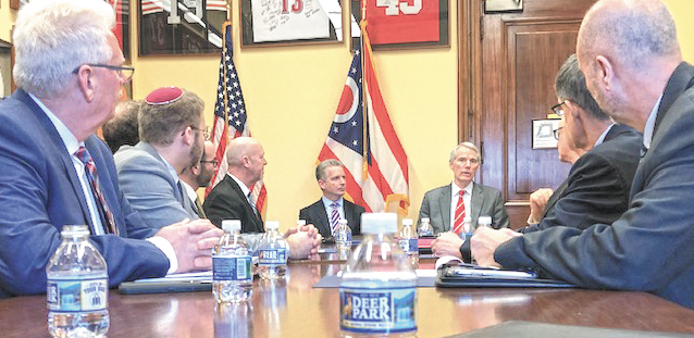 Meeting with U.S. Sen. Rob Portman (R-OH) on March 13 are Jewish Federation of Greater Dayton Technology and Facilities Director Roger Apple (L) and Dayton Jewish Community Relations Council Director Rabbi Ari Ballaban (2nd from L)