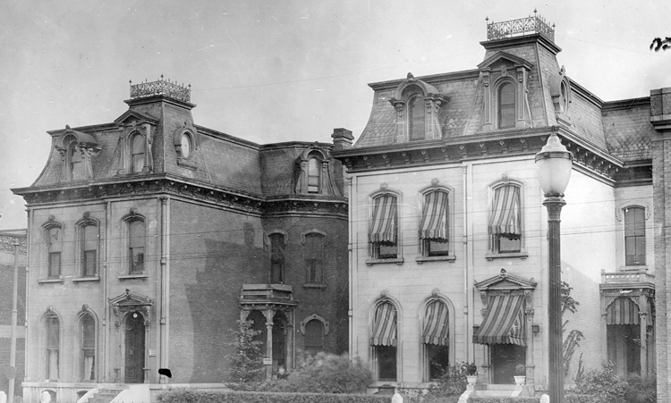 In 1876, Isaac Pollack and Sol Rauh built identical mansions on lots at 319 and 321 W. Third St. in Dayton. According to legend, under the shade of a tree, they tossed a coin to determine that Pollack would live at 319 (R) and Rauh would live at 321. Photo: Dayton Metro Library.