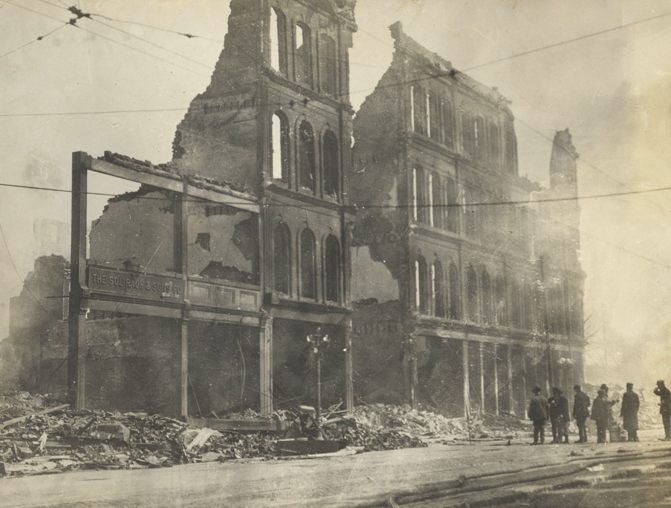 The Sol Rauh & Sons Co. building at 107 E. Third St. was destroyed in the fire that followed the Great Flood of 1913. The distillers and wholesale liquor dealers rebuilt at the same site. Photo; Dayton Metro Library.