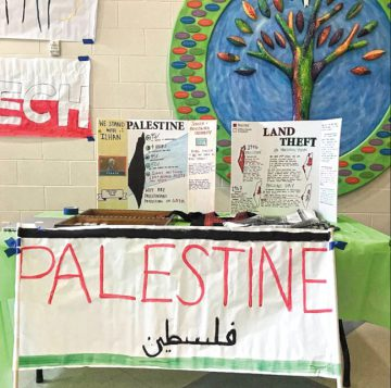 The Palestine table at Miami Valley Upper School's May 10 World Affair presented maps indicating that all land in the state of Israel was stolen from Palestinians. Photo: Devorah Schwartz.